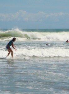 Surfing at Kuta Beach in Bali